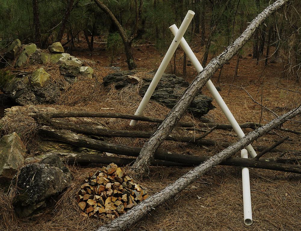 <em>Composition with Rocks & Plastic Pipe</em>